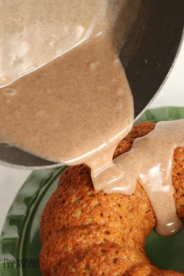Pour the cinnamon glaze over the applesauce cake.