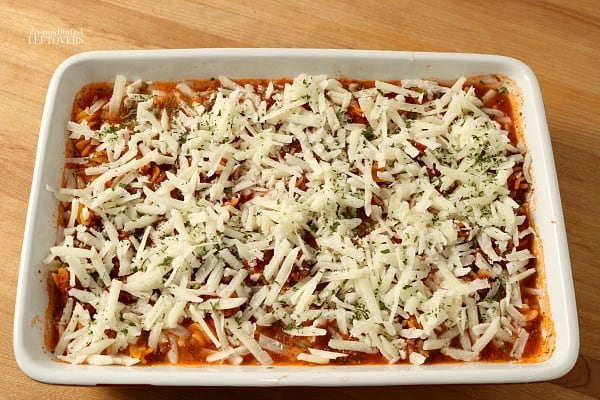 Top pasta casserole with cheese.