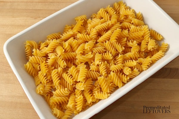 Put the pasta noodles in casserole dish.
