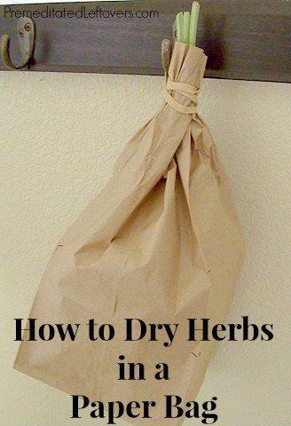 Drying herbs in a brown paper bag