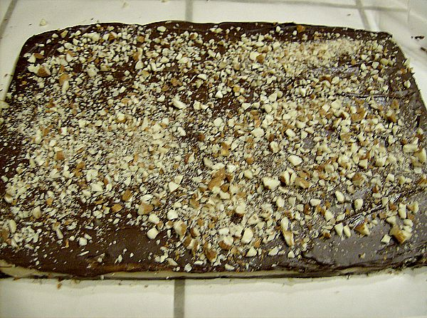 Melt one cup of chocolate chips in the double boiler and spread over toffee. Immediately top with finely chopped nuts.