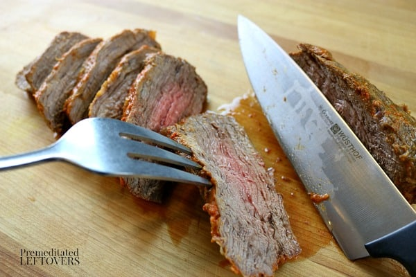 Slice the cooked tri-tip after allowing it to rest for 5 minutes