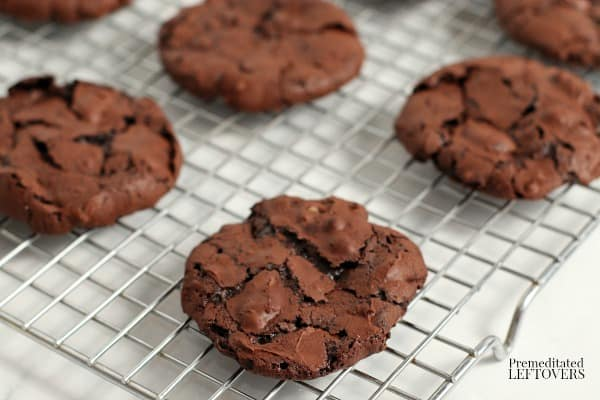 flourless chocolate cookies on a cooling rack