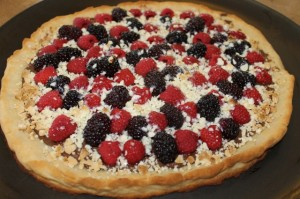 gluten-free dessert pizza covered with fruit and chocolate