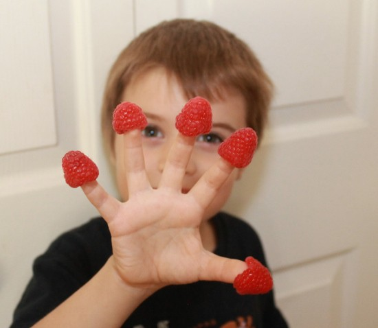 Driscoll's Rasberries on my son's fingers (550x478)