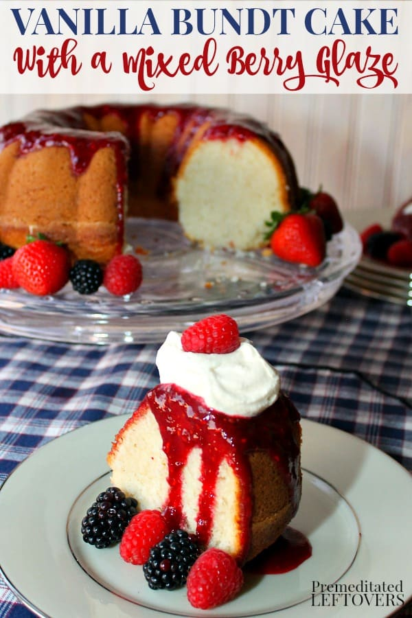Easy Vanilla Bundt Cake Recipe with Berry Glaze on a cake platter with a slice of cake on a plate topped with mixed berry glaze, berries, and homemade whipped cream.