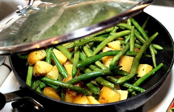 Garlic Green Beans and Potatoes sauteeing in Sauté Express® Garlic and Herb Sauté Starter.