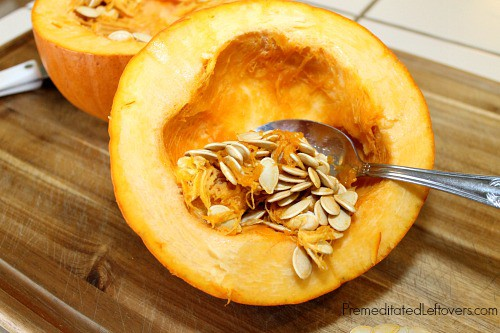 Remove the pumpkin seeds - A grapefruit spoon can speed up the process