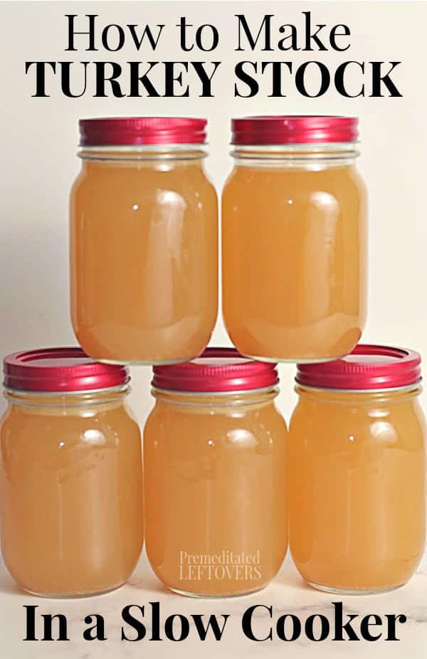5 mason jars of homemade turkey stock that was made in a crock pot