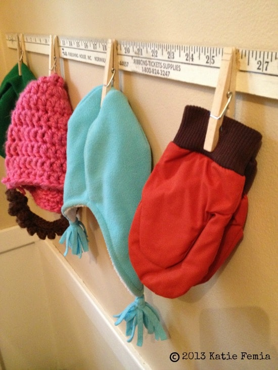$2.00 DIY Mitten holder made using a yard stick and clothes pins - easy way to keep hats and gloves organized!