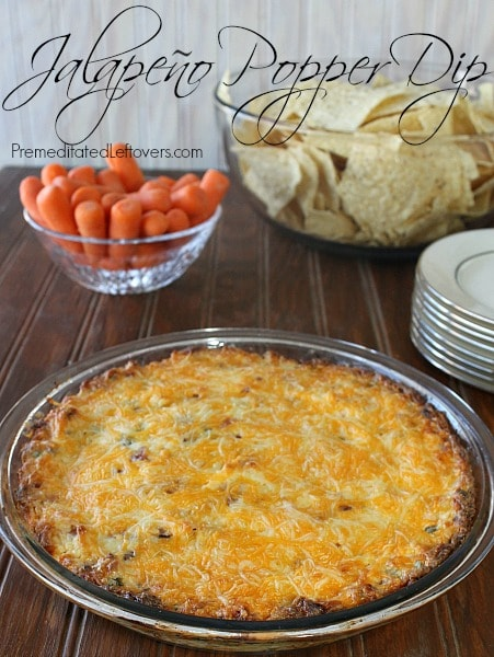 Baked Jalapeno Popper Dip recipe is served in pie dish with chips and carrots. It's a delicious appetizer.