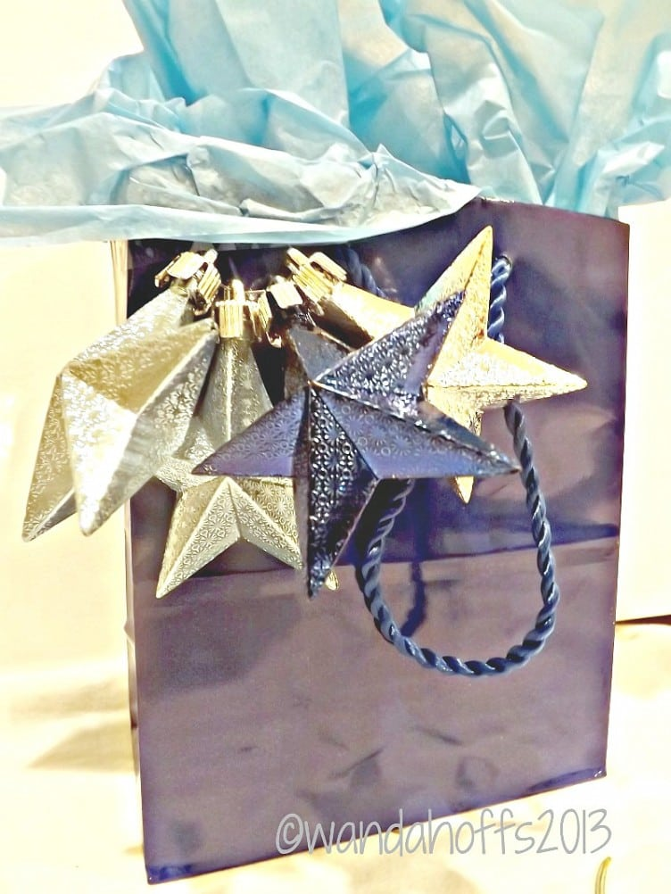 Use ornaments to dress up gift bags for Christmas