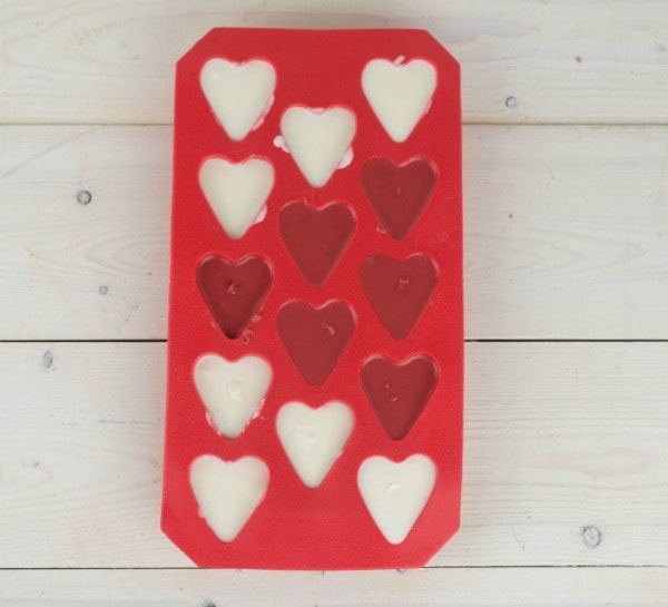 Pour melted chocolate into molds to make Chocolate Hearts