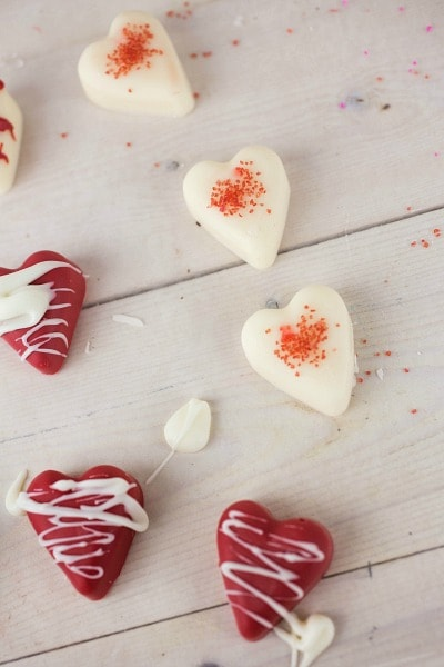 add melted chocolate or colored sprinkles to the top of the candy hearts
