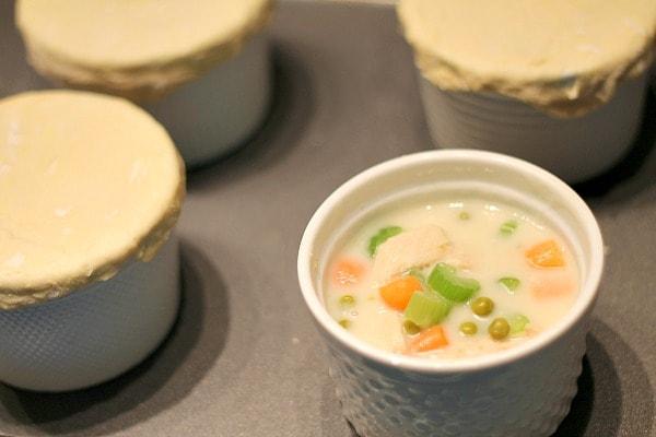 Divide chicken pot pie filling between 4 ramekins