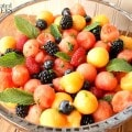 Mojito Fruit Salad: Watermelon & Berry Salad with Mint-Lime Dressing - A ruit salad made of watermelon, cantaloupe, and berries flavored with mint and lime.