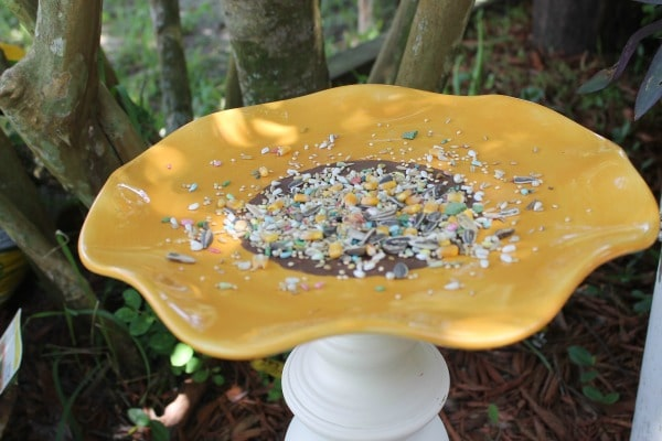 Diy sunflower bird feeder from an upcycled lamp for Bird seed glue recipe