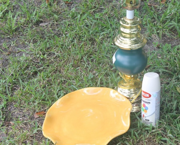 Items needed to make a sunflower bird feeder from an old lamp and plate.