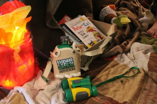 Use toys and stuffed animals to create an outdoor feel for your kids indoor camp out