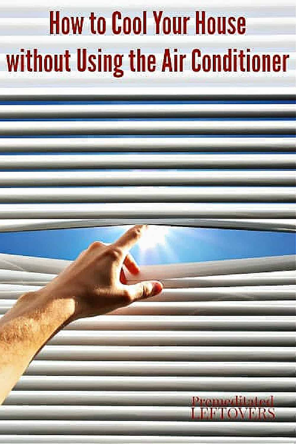 closed blinds blocking out the hot summer sun to keep the house cool without using the air conditioner