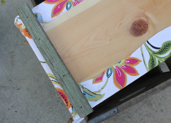 Attaching top to crate to make an ottoman.