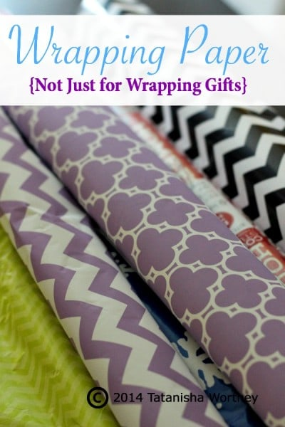 Using Wrapping Paper to Cover Tables - Frugal Table Decor Ideas. There are so many awesome ways you can use wrapping paper to decorate tables.