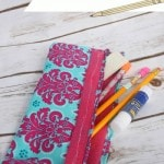 DIY Pencil Pouch Tutorial - Try this easy pencil pouch tutorial to create a pencil pouch for back to school. Uses scrap fabric, vinyl and velcro.