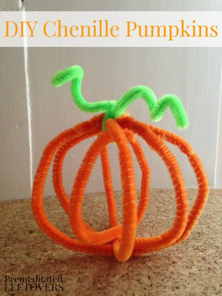 DIY Chenille Pumpkins - A fun fall craft for kids. You can make these Chenille Pumpkins for one dollar. All you need is orange and green pipe cleaners.