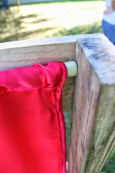 puppet theater curtain put in place with an adjustable rod