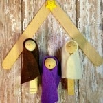 Clothespin Nativity Scene with a Popsicle Stick Stable- This Nativity scene is a simple and frugal craft. Enjoy making one with your family this Christmas.