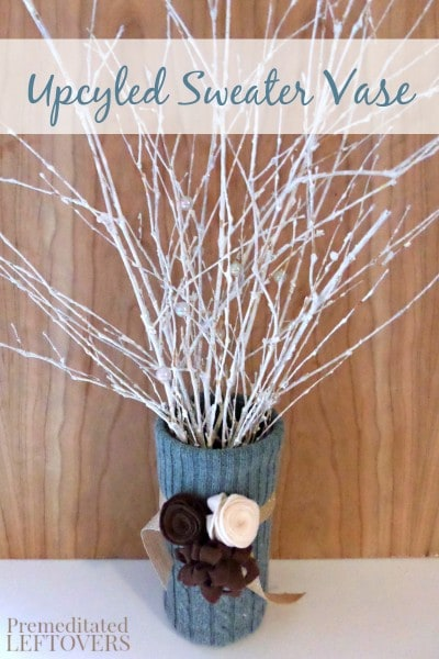 This Upcycled Sweater Vase is a great way to repurpose an old sweater and an attractive and unique way to decorate a vase.