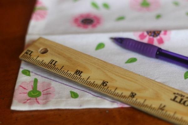 Measuring tea towel to make an apron
