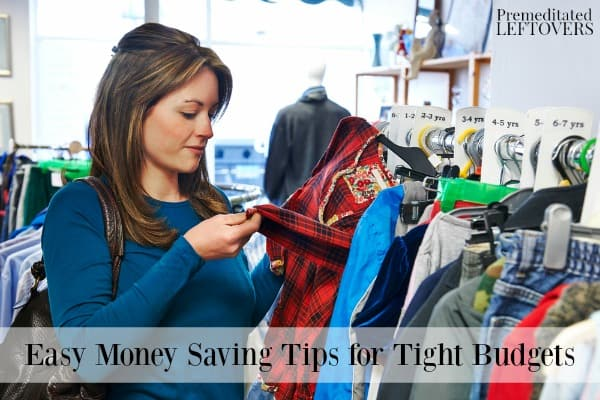 Woman shopping in a thrift store to save money on a tight budget