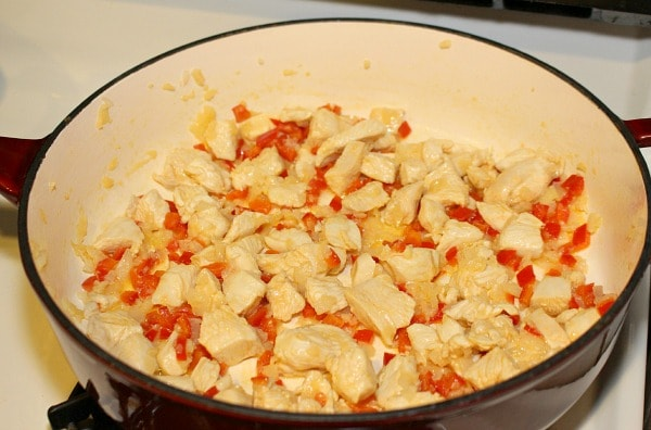 Saute chicken, red pepper, onion, and garlic for Chicken and Red Pepper Pasta Skillet Recipe with Spinach