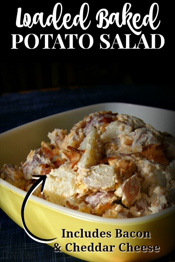 Loaded baked potato salad in a bowl topped with cheddar cheese and bacon.