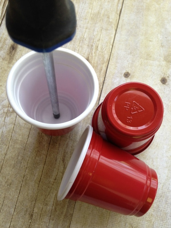 How to make red solo cup party lights - making holes for the light strand