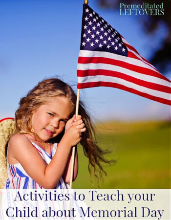 a little girl holding an American flag on Memorial Day