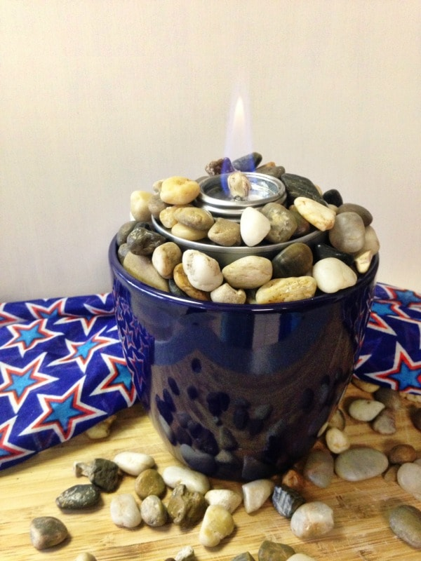 How to Make a Tabletop Fire Pit with a planter, rocks, and a chafing fuel cup. Use this easy tutorial to make a mini tabletop fire pit for summer parties.