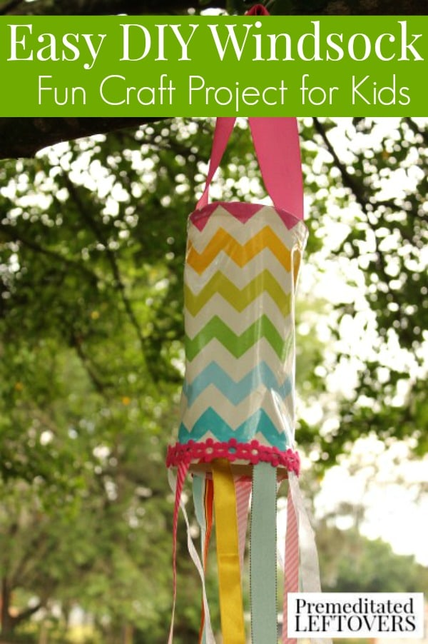 Homemade Windsock for Kids - Create a pretty, bright, and fun windsock with the kids to make your yard or porch festive. Easy craft project for kids.