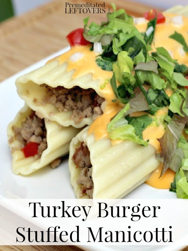 Turkey Burger Stuffed Manicotti Recipe - A new flavorful twist on a classic dinner dish that your family will love. Try this easy stuffed manicotti recipe!