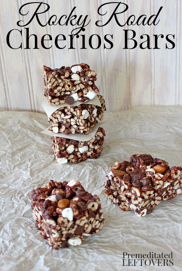 A quick and easy no-bake cereal bar treat: Rocky Road Cheerios Bars Recipe. This tasty snack is made with cheerios, chocolate chips, marshmallows, and nuts.