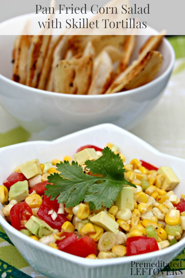 Pan Fried Corn Salad with Skillet Tortilla Chips- Looking for a great Tex Mex side dish? Try this colorful corn salad recipe with homemade tortilla chips.