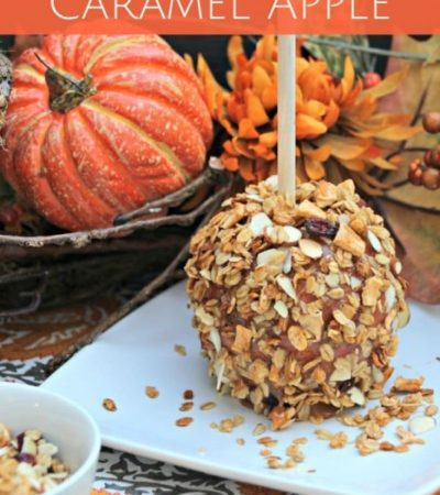 Granola Coated Caramel Apple- Try these candy apples for an easy fall treat. Crunchy granola, sweet caramel, and a tart apple make the perfect combination.