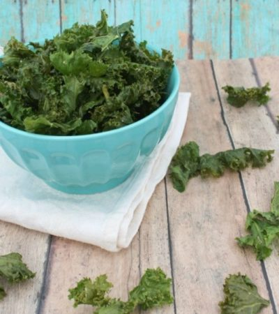 Crispy Kale Chips- These baked kale chips are incredibly easy to make. Enjoy them plain or with your favorite seasonings for a healthy and guilt-free snack.