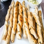 Garlic & Kale Breadsticks with Honey Herb Butter- These homemade breadsticks are baked with flavorful ingredients and topped with a delicious herb butter.
