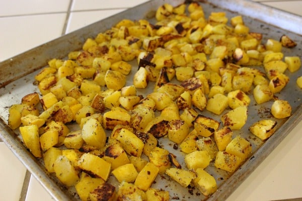 Roasted Acorn Squash Recipe on baking sheet ready to be served with dinner.