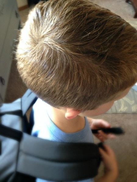 Homemade Lice Spray for Kids sprayed on hair