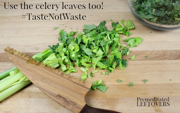 Chopping celery leaves along with celery