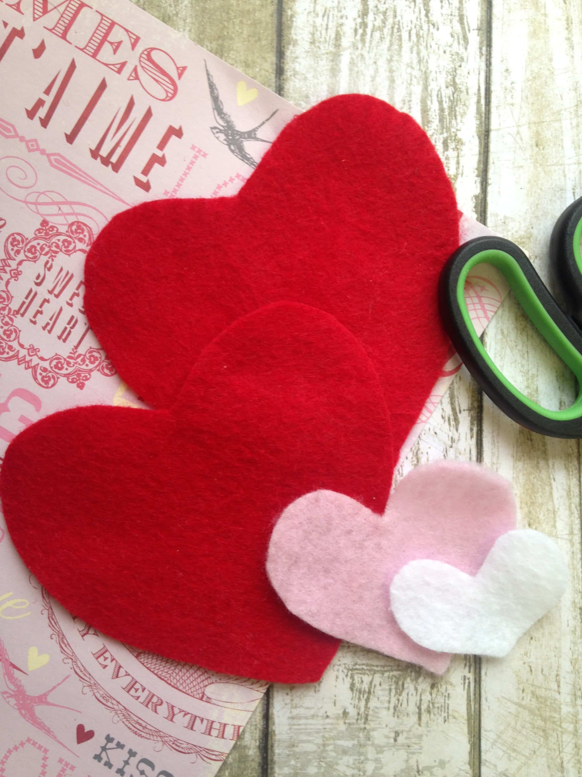 Cut felt hearts from 3 different colors of felt to make this essential oil scented Felt Heart Sachet