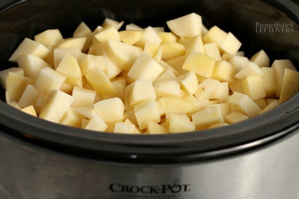 5 pounds of cut up potatoes in slow cooker.